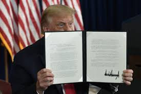 With his signature, Trump promises COVID-19 and economic collapse will miraculously go away.