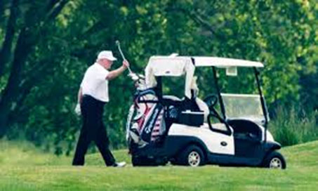 While we wait in food lines, Trump golfs.